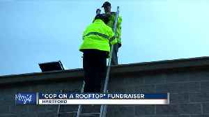 Cops on rooftop brave rain to raise money for Special Olympics [Video]