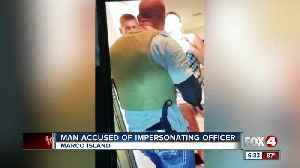 Man accused of impersonating a police officer after trying to evict woman [Video]