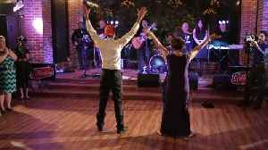 Mother and son break out into choreographed wedding dance [Video]
