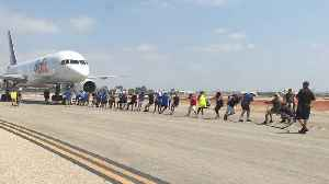 How Many People Does it Take to Pull a Plane Across a Runway? [Video]