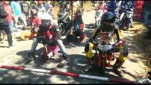 Locals in Indonesia hurtle down hills at 40mph on wooden tricycles [Video]