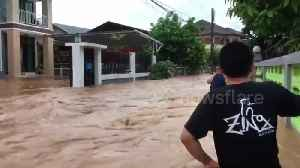 River busts banks in Thailand after downpour [Video]