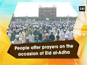 People offer prayers on the occasion of Eid al-Adha [Video]