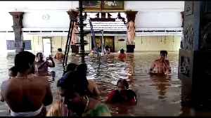 Devotees pray at submerged temple during Kerala floods [Video]