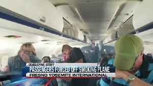 Passengers forced from smokey plane in Fresno [Video]