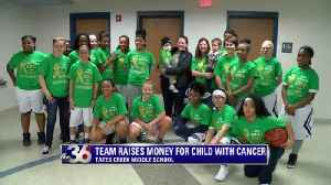 Middle school hoops team raises money for child with cancer [Video]