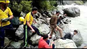 Rescue workers pull out horse from flooded river in Himalayas [Video]