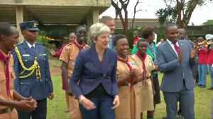 UK's May boogies with Kenyan scouts [Video]