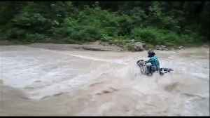 Moment man on motorbike is swept away in northern India floods [Video]