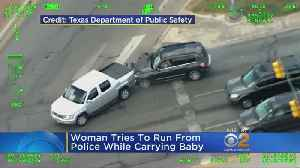 WATCH: Woman Tries To Run From Police While Carrying Baby [Video]