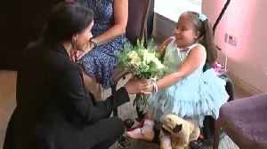 Meghan Markle Gives Flower to 7-Year-Old Girl With Spina Bifida [Video]