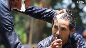 Chinese barber gives haircut with razor-sharp SICKLE [Video]