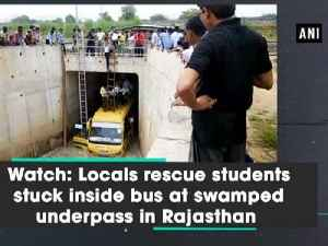 Watch: Locals rescue students stuck inside bus at swamped underpass in Rajasthan [Video]
