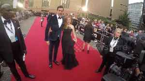Isla Fisher and Sacha Baron Cohen arrive at 2018 GQ Awards [Video]