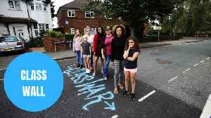 Council accused of 'class war' after resurfacing road on a once divided wall from rich to poor [Video]