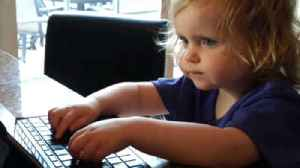 Two-year-old pretends to work on iPad [Video]
