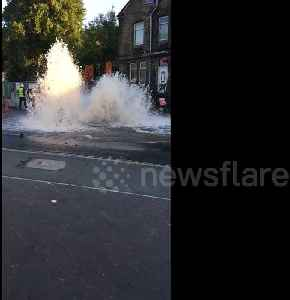 West Yorkshire mains water pipe bursts on busy road [Video]