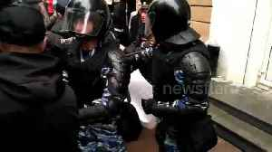 Russian couple is arrested by riot police during rally against pension reform plan [Video]