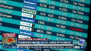 Passengers take early flights out of Denver to get to North Carolina ahead of Florence [Video]