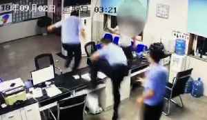 Cops Tackle Drunk Disco Dancing In Police Station [Video]