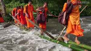 Dog Crosses Raging River With Monks [Video]