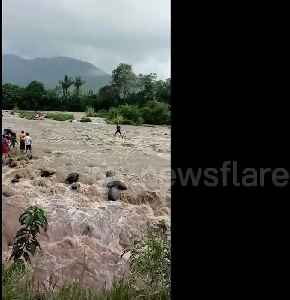 Nail-biting moment fisherman is rescued from middle of raging rapids [Video]