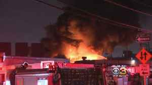 Firefighters Battle Raging Junkyard Fire In North Philly [Video]