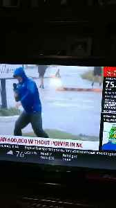 News video: Weather Channel reporter braces against wind as others just stroll by