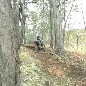 Woman Faceplants After Failing Log Drop-Off on Mountain Bike [Video]