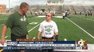 Nate Petrey, football coach with Down syndrome has special bond with head coach, team [Video]