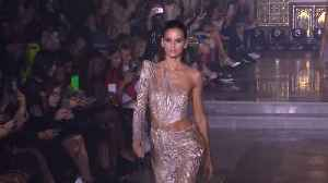 Sparkles, metallics and thigh-high splits at Julien Macdonald show [Video]