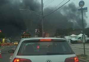 Thick Black Smoke Billows From Parking Garage Fire in Brooklyn [Video]