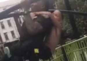 New York Police Officer Does 5 Pull-Ups With Ease - Even With a Kid on His Back [Video]