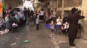 Waving chickens and emptying pockets - Jews prepare for Yom Kippur