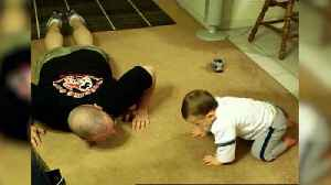 Baby Tries to Mimic Dad's Push-ups [Video]