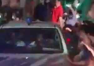 Crowd Showers Petals on Former Prime Minster's Car After Release From Jail [Video]