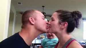Parent Smooches Makes This Baby Crack Up Laughing [Video]