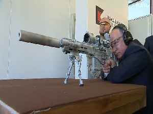Putin tests Kalashnikov's latest sniper's rifle [Video]