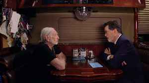 Stephen Interviews Willie Nelson On His Tour Bus [Video]