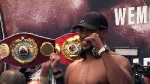 Anthony Joshua and Alexander Povetkin weigh-in [Video]