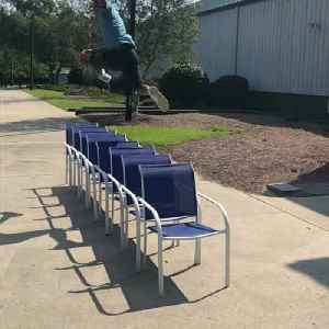 Guy Leaps Over Chairs Lined up Together [Video]