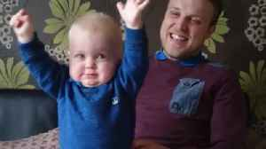 Baby's priceless reaction to dad's soccer chant [Video]