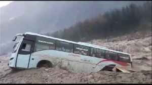 Dramatic moment bus is swept away by floods in northern India [Video]