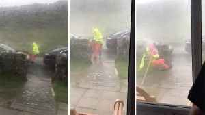 Shocking moment traffic woman is blown over by strong wind during storm Ali� [Video]