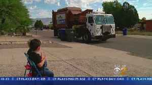 Boys Cheer On Garbage Truck From Driveway [Video]