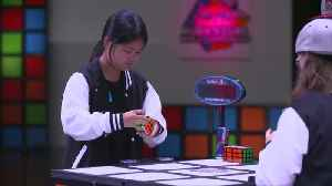 Speedy fingers compete in Rubik's Cube championship [Video]