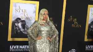 Lady Gaga sparkles in silver at 'A Star is Born' premiere [Video]