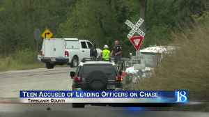 Multi-County chase ends as 15-year-old swerves to avoid train [Video]