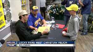 Yelich signs autographs day after Brewers clinch spot in playoffs [Video]