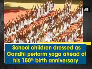 School children dressed as Gandhi perform yoga ahead of his 150th birth anniversary [Video]